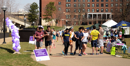 marchers: ANN ARBOR, MI - APRIL 12: Walkers participate in the University of Michigans Relay for Life event on April 12, 2014 in Ann Arbor, MI.  Editorial