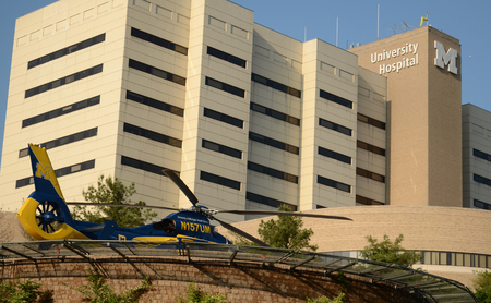 ANN ARBOR, MI - JUNE 3: Survival Flight helicopter sits at its helipad at the University of Michigan hospital on June 3, 2014 in Ann Arbor, MI.  Survival flight has transported over 57,000 patients in over 30 years.