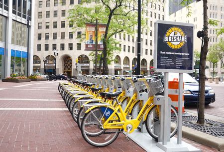 INDIANAPOLIS - JUNE 15: Bicycle rental station in Indianapolis, shown June 15, 2014. Within the first month after the program launch in April 2014 13,000 riders had used the Pacers Bike Share program.