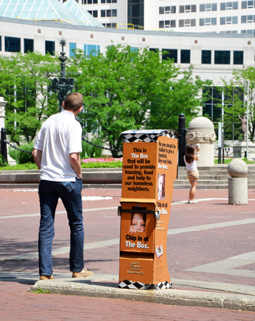 coalition: INDIANAPOLIS - JUNE 16:  Boxes such as this one in downtown Indianapolis, shown on June 16, 2014, are used to collect funds for the Coalition for the Homeless Intervention and Prevention organization.