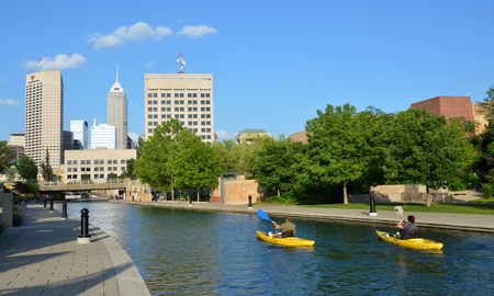 INDIANAPOLIS - JUNE 17:  Kayakers enjoy the Central Canal in downtown Indianapolis on June 17, 2014. The three mile loop is a popular walking and jogging downtown trail.