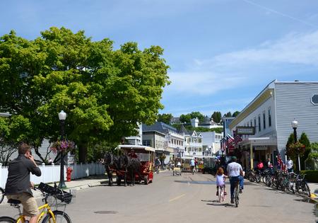 mackinac: MACKINAC ISLAND, MI, USA- JUNE 21: Bicyclist ride toward downtown Mackinac Island, MI on June 21, 2014. No powered automobiles are allowed on the island.  Editorial