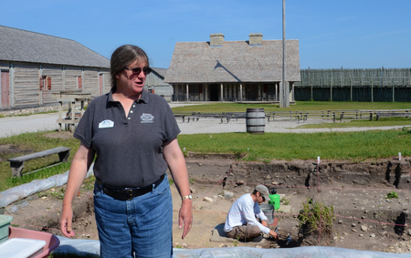 MACKINAW CITY, MI, USA- JUNE 22: Lynn Evans, Curator of Archaelogy for Mackinac State Historic Parks, explains a current archaeological dig at Fort Michilimackinac in Mackinaw City, MI on June 22, 2014.  Editorial