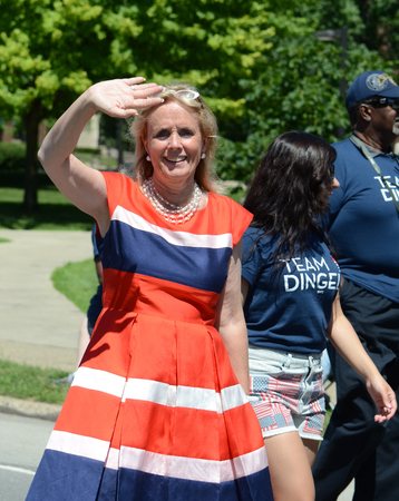 congressional: YPSILANTI, MI - JULY 4: Debbie Dingell, Democratic candidate for Michigans 12th congressional district, waves at the 4th of July parade on July 4, 2014 in Ypsilanti, MI.