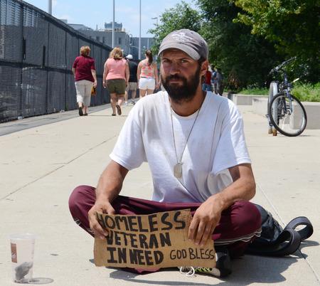 DETROIT, MI - JULY 6: Homeless veteran begs for money in Detroit, MI on July 6, 2014