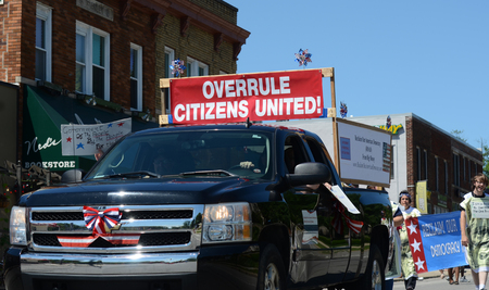 marchers: YPSILANTI, MI - JULY 4: Marchers opposed to the Citizens United decision march at the 4th of July parade on July 4, 2014 in Ypsilanti, MI.