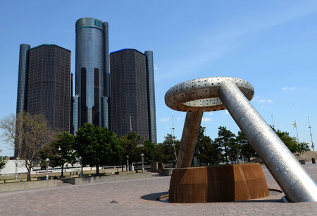 DETROIT, MI - JULY 6: The Renaissance Center, shown here behind Hart Plaza in downtown Detroit on July 6, 2014, houses the world headquarters of General Motors.   Redakční