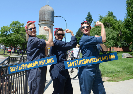 YPSILANTI, MI - JULY 4: Three women dressed as Rosie the Riveter advertise the campaign to preserve part of the Willow Run bomber plant after the 4th of July parade in Ypsilanti, MI July 4, 2014. Editöryel