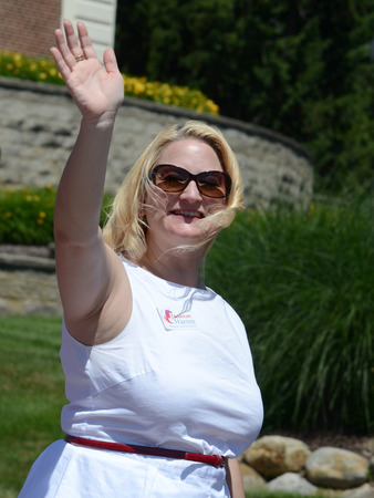 congressman: YPSILANTI, MI - JULY 4: Michigan State Senator Rebekah Warren waves at the 4th of July parade on July 4, 2014 in Ypsilanti, MI. Editorial
