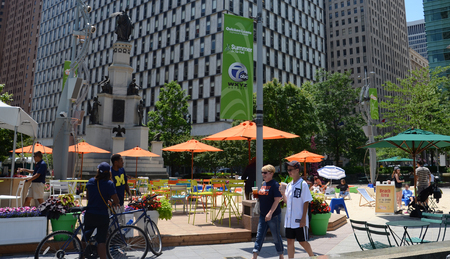 revitalization: DETROIT, MI - JULY 6: People enjoying the revitalized Campus Martius park in Detroit, MI, on July 6, 2014.