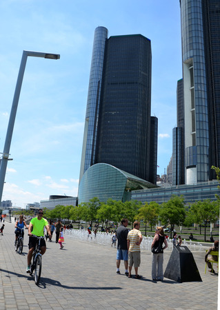 DETROIT, MI - JULY 6: People enjoy the day at the GM Plaza and Promenade, on the Detroit International Riverfront in Detroit, MI on July 6, 2014.