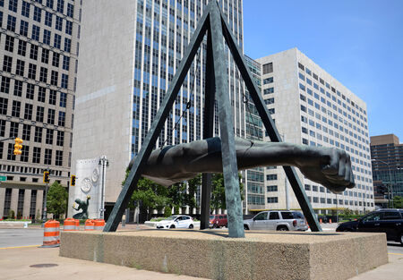 joe louis: DETROIT, MI - JULY 6: The Fist, a monument to Joe Louis in Detroit, MI, shown here on July 6, 2014, is the work of sculptor Robert Graham. The Spirit of Detroit statue can be seen in the background.