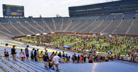 ANN ARBOR, MI - AUGUST 10:  University of Michigan football fans wait to enter the field at Michigan Football Youth Day on August 10, 2014 in Ann Arbor, MI.