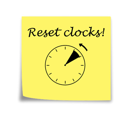 Sticky note reminder to set clocks back, black on yellow