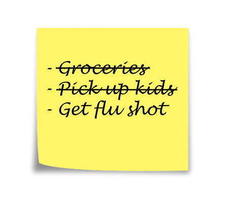 Sticky note reminder to get flu shot, black on yellow photo