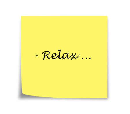 Sticky note reminder to relax, black on yellow