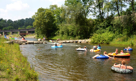 floaters: ANN ARBOR, MI - AUGUST 3: Floaters and kayakers enjoy the Huron river at the Argo Cascades in Ann Arbor, MI on August 3, 2014.