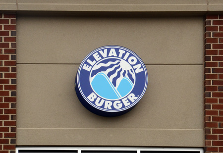 whose: ANN ARBOR, MI - AUGUST 24: Elevation Burger, whose logo for their east Ann Arbor store is shown on August 24, 2014, is the first and largest organic burger chain in the country.