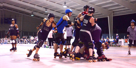 blackouts: ANN ARBOR, MI - JULY 12: Ann Arbor Brawlstars jammer passes the pack in a roller derby game against the Northern Kentucky Blackouts in Ann Arbor, MI on July 12, 2014.