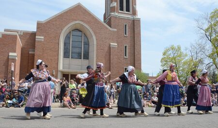 dance time: HOLLAND, MI - MAY 3: Tulip Time Festival dancers perform a mother-daughter dance in Holland, MI May 3, 2015.