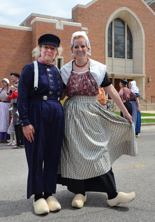 dance time: HOLLAND, MI - MAY 3: Tulip Time Festival dancers pose after performing the mother daughter dance in Holland, MI May 3, 2015. Editorial