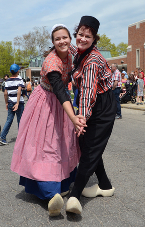 dance time: HOLLAND, MI - MAY 3: Tulip Time Festival dancers pose after performing the mother-daughter dance in Holland, MI May 3, 2015. Editorial