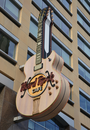 hard rock cafe: DETROIT, MI - DECEMBER 24: The Detroit, MI Hard Rock Cafe, whose guitar logo is shown on December 24, 2015, houses memorabilia from many Michigan musicians. Editorial