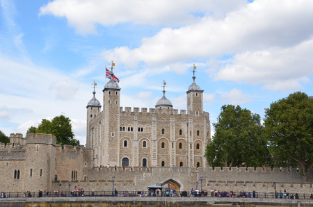 beefeater: LONDON - AUGUST 6: The Tower of London, shown from the river Thames on August 6, 2015, houses the British Crown Jewels.