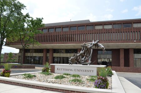 orbits: FLINT, MI - AUGUST 22: The Campus Center of Kettering University, shown here on August 22, 2015, includes Michael Dunbar�s The Orbits of Isaac sculpture.