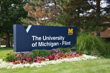 flint: FLINT, MI - AUGUST 22: The University of Michigan Flint, whose sign is shown on August 22, 2015, is documentary director Michael Moore�s alma mater. Editorial
