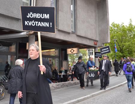protesters: REYKJAVIK, ICELAND - JUN 17:  Protesters hold up signs on independence day in Reykjavik Iceland on June 17, 2015.