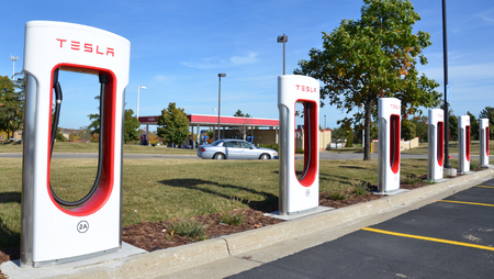 supercharger: ANN ARBOR, MI - OCTOBER 10: The Tesla Supercharger station in Ann Arbor, MI, shown here on October 10, 2015, can provide 170 miles of charge in 30 minutes.