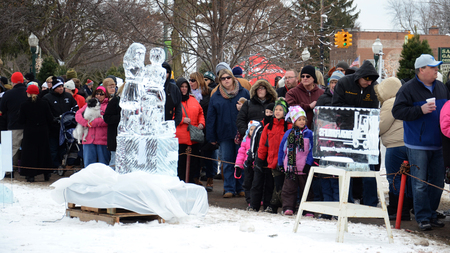 PLYMOUTH, MI - JANUARY 11:  People viewing the sculptures at the Plymouth Ice Festival on  January 11, 2015.