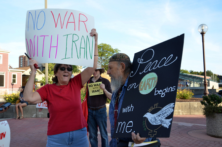 alan: ANN ARBOR, MI - SEPTEMBER 10:  Alan Haber, first president of Students for a Democratic Society, right, speaks to another participant at a peace rally in Ann Arbor, MI on September 10, 2015.