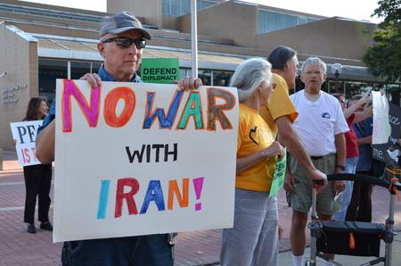 arbor: ANN ARBOR, MI - SEPTEMBER 10:  Protesters participate in peace rally in Ann Arbor, MI on September 10, 2015.