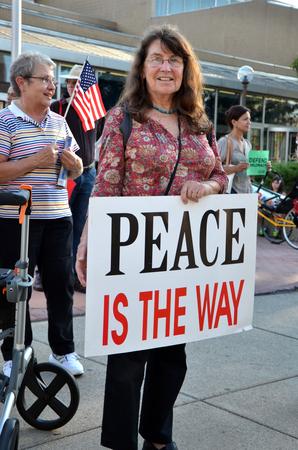 arbor: ANN ARBOR, MI - SEPTEMBER 10: Odile Hugonot-Haber participates in a peace rally in Ann Arbor, MI on September 10, 2015. Editorial