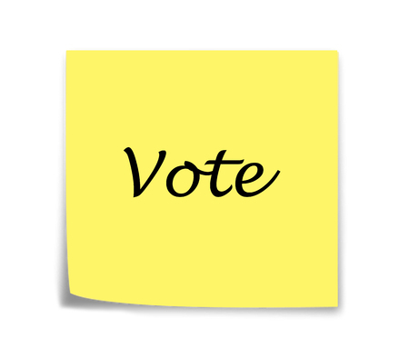 italics: Sticky note reminder to vote in italics Stock Photo
