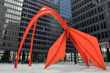CHICAGO - MAY 29: Flamingo, in the Federal Plaza in Chicago, is shown here on May 29, 2016. The stabile was constructed by American sculptor Alexander Calder, under the Percent for Art program. Stock fotó - 80295173
