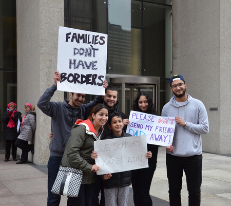 he: DETROIT, MI - FEBRUARY 28:  Supporters of Yousef Ajin march in Detroit, MI on February 28, 2017 outside of his immigration hearing. He was allowed to remain in the country.