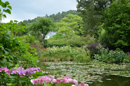 GIVERNY, FRANCE - AUG 5:  The house of artist Claude Monet can be seen across the pond in his garden in Giverny, France, on August 5, 2016. Editorial