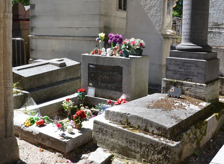 morrison: PARIS - AUG 7:  The tombstone of Jim Morrison at Pere Lachaise Cemetery in Paris, France is shown on August 7, 2016. He was the lead singer of The Doors.