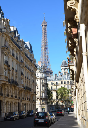 PARIS - AUG 13:  The Eiffel Tower in Paris, France is shown from a side street on August 13, 2016. It was originally the entrance to the 1889 World Fair.