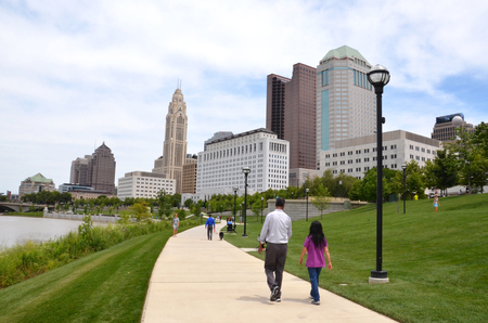 COLUMBUS, OH - JUNE 28: Walkers on the Scioto Mile in downtown Columbus, Ohio are shown on June 28, 2017.