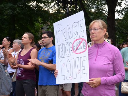 ANN ARBOR, MI - AUG 13: A woman holds up a sign at a rally in solidarity with the counter-protesters of Charlottesville, VA in Ann Arbor, MI on August 13, 2017. Sajtókép
