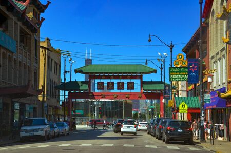 CHICAGO, IL  USA - AUGUST 12, 2017: Chicago's Chinatown, whose gate is shown on a sunny summer afternoon, hosts many festivals throughout the year.
