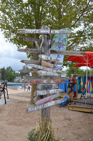 SOUTH HAVEN, MI  USA - AUGUST 12, 2017: MIlepost sign at South Haven beach on Lake Michigan, directs visitors.