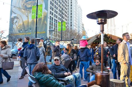 DETROIT, MI  USA - NOVEMBER 24, 2017:  Visitors relax at the Cadillac Square Marketplace in downtown Detroit.