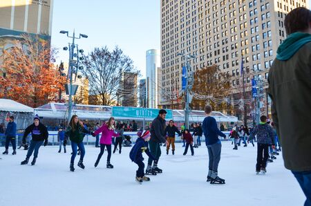 DETROIT, MI  USA - NOVEMBER 24, 2017: People skate in the rink at Campus Martius park in downtown Detroit.