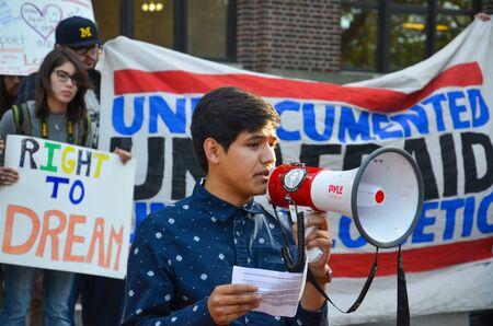 ANN ARBOR, MI  USA - SEPTEMBER 8, 2017: DACA student Javier Contreras speaks at a pro - DACA rally at the University of Michigan. Sajtókép