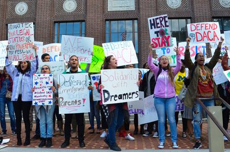 ANN ARBOR, MI  USA - SEPTEMBER 8, 2017: Protesters show their support for dreamers at a pro - DACA rally at the University of Michigan.